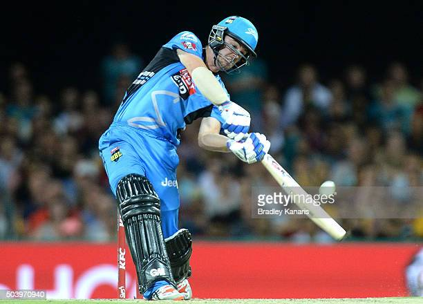 Travis Head of the Strikers hits the ball to the boundary for a four during the Big Bash League match between the Brisbane Heat and the Adelaide...
