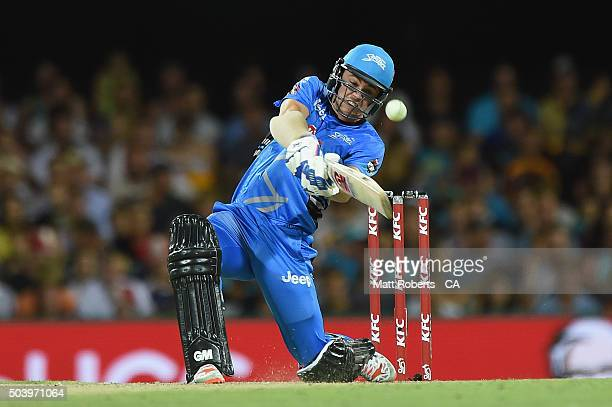 Travis Head of the Strikers is stuck by the ball while batting during the Big Bash League match between the Brisbane Heat and the Adelaide Strikers...
