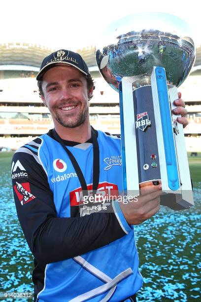 Travis Head of the Strikers poses with the trophy after winningthe Big Bash League Final match between the Adelaide Strikers and the Hobart...