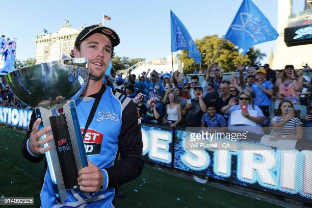 Travis Head of the Strikers presents the trophy after winning the Big Bash League Final match between the Adelaide Strikers and the Hobart Hurricanes...