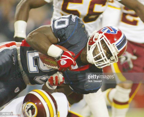Travis Henry of the Buffalo Bills looks for the first down marker against the Washington Redskins on October 19 2003 at Ralph Wilson Stadium in...