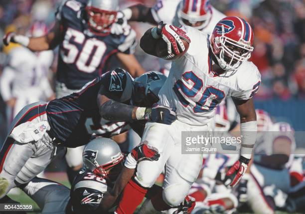 Travis Henry Running Back for the Buffalo Bills runs the ball during the American Football Conference East game against the New England Patriots on...