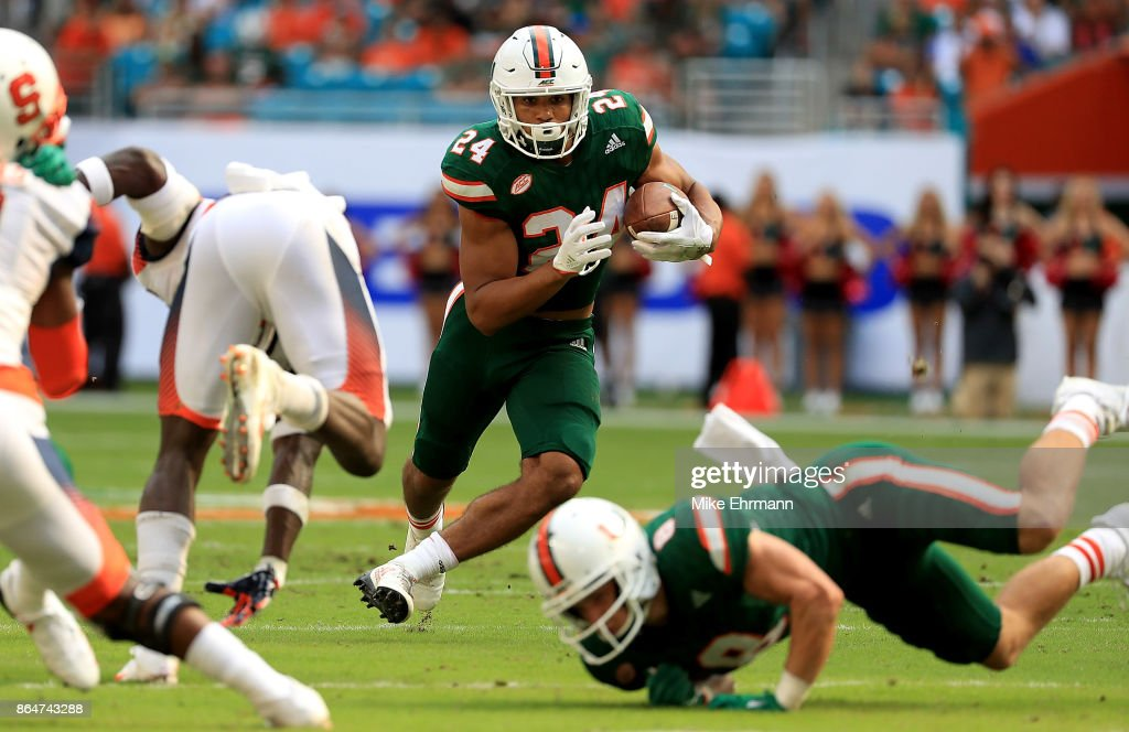 Travis Homer #24 of the Miami Hurricanes rushes during a game against the Syracuse Orange at Sun Life Stadium on October 21, 2017 in Miami Gardens, Florida.