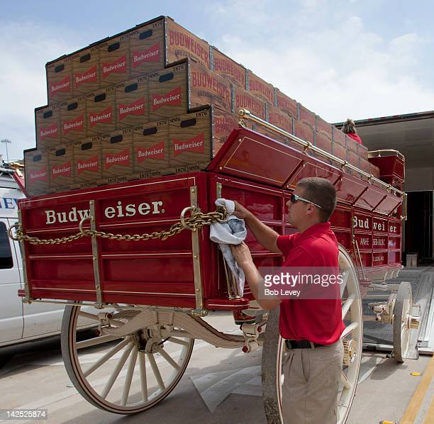 Travis Houser polishes up the Budweiser clydesdale wagon before the game between the Colorado Rockies and the Houston Astros on Opening Day at Minute...