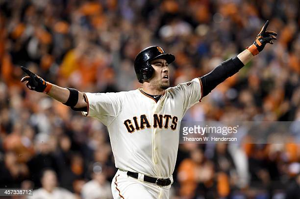 Travis Ishikawa of the San Francisco Giants celebrates after he hits a three-run walk-off home run to defeat the St. Louis Cardinals 6-3 during Game...