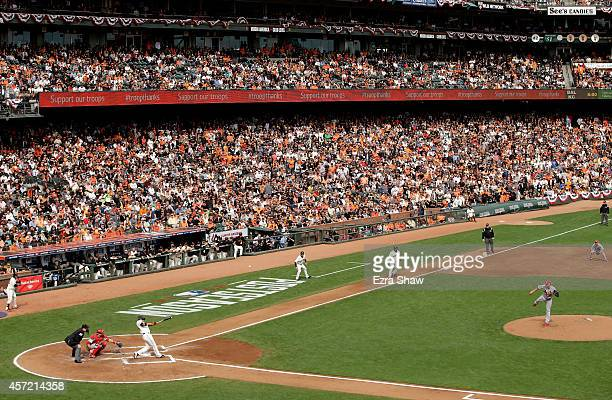 Travis Ishikawa of the San Francisco Giants hits a three RBI double in the first inning against the St Louis Cardinals during Game Three of the...