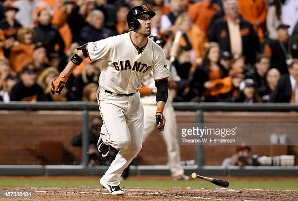 Travis Ishikawa of the San Francisco Giants hits a threerun walkoff home run to defeat the St Louis Cardinals 63 during Game Five of the National...
