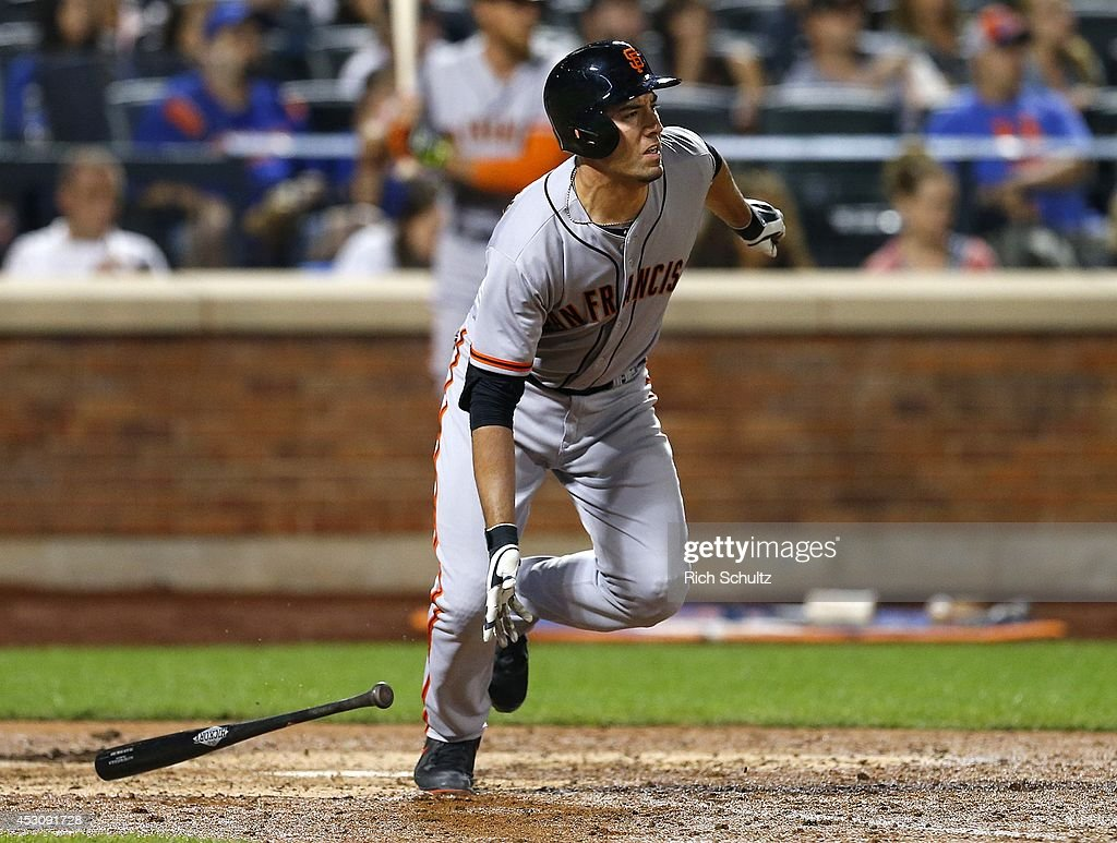 Travis Ishikawa #45 of the San Francisco Giants runs to first after hitting a two run single during the seventh inning against the New York Mets on August 2, 2014 at Citi Field in the Flushing neighborhood of the Queens borough of New York City. The Mets defeated the Giants 4-2.