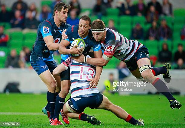 Travis Ismaiel of the Bulls is tackled by Luke Jones of the Rebels during the round 17 Super Rugby match between the Rebels and the Bulls at AAMI...