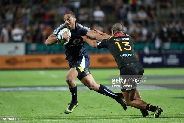 Travis Ismaiel of the Bulls with the ball tackled by Anton LienertBrown during the round six Super Rugby match between the Chiefs and the Bulls at...