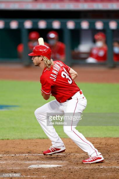 Travis Jankowski of the Cincinnati Reds drives in the winning run with an infield single in the eighth inning of an exhibition game against the...