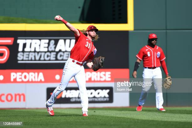 Travis Jankowski of the Cincinnati Reds throws the ball in from left field during the first inning of a spring training game against the Texas...