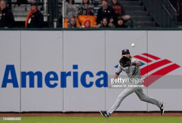 Travis Jankowski of the San Diego Padres catches a fly ball against the San Francisco Giants in the bottom of the first inning at AT&T Park on...