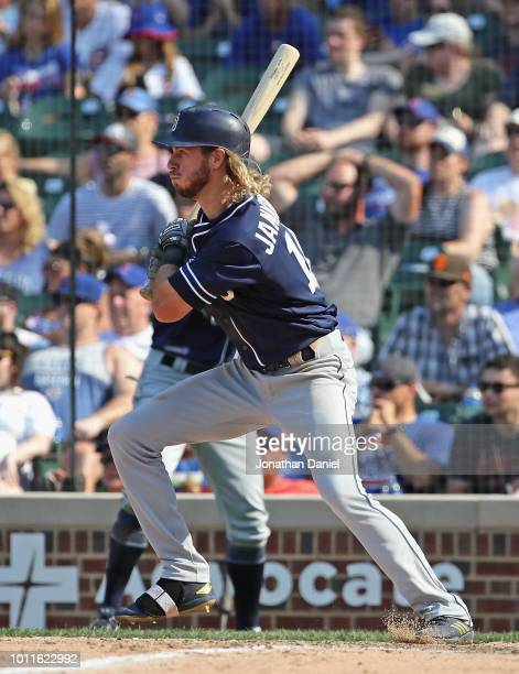 Travis Jankowski of the San Diego Padres hits a two run single in the 9th inning against the Chicago Cubs at Wrigley Field on August 5, 2018 in...