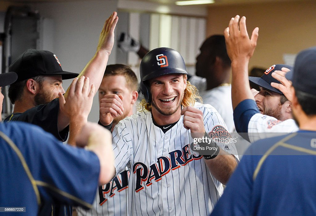 Travis Jankowski #16 of the San Diego Padres is congratulated after scoring during the fifth inning of a baseball game against the Philadelphia Phillies at PETCO Park on August 6, 2016 in San Diego, California.