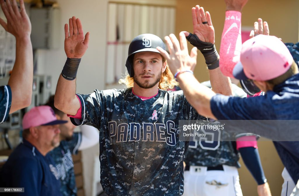 Travis Jankowski #16 of the San Diego Padres is congratulated after scoring during the fourth inning of a baseball game against the St. Louis Cardinals at PETCO Park on May 13, 2018 in San Diego.
