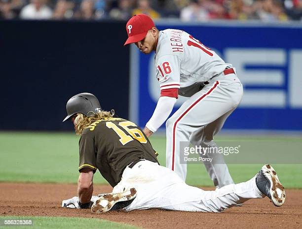 Travis Jankowski of the San Diego Padres is tagged out at second base by Cesar Hernandez of the Philadelphia Phillies during the seventh inning of a...