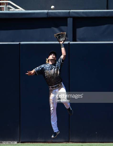 Travis Jankowski of the San Diego Padres makes a leaping catch on a ball hit by Carlos Santana of the Philadelphia Phillies during the fourth inning...