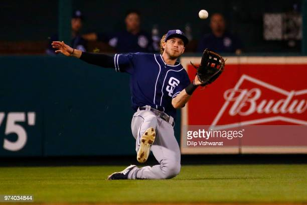 Travis Jankowski of the San Diego Padres makes a sliding catch against the St. Louis Cardinals in the fifth inning at Busch Stadium on June 13, 2018...