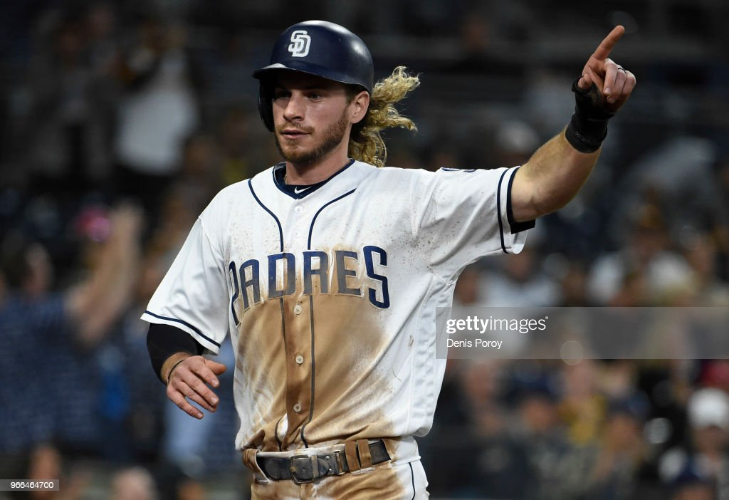 Travis Jankowski #16 of the San Diego Padres points to the infield after scoring during the eighth inning of a baseball game against the Cincinnati Reds at PETCO Park on June 2, 2018 in San Diego, California.