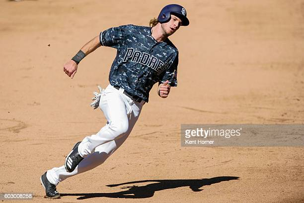 Travis Jankowski of the San Diego Padres rounds 3rd base on his way to scoring a run in the 6th inning againt the Colorado Rockies at PETCO Park on...
