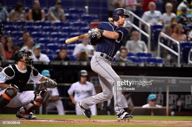 Travis Jankowski of the San Diego Padres singles in the first inning against the Miami Marlins at Marlins Park on June 9, 2018 in Miami, Florida.