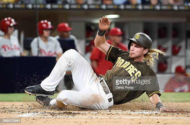 Travis Jankowski of the San Diego Padres slides as he scores during the third inning of a baseball game against the of the Philadelphia Phillies at...