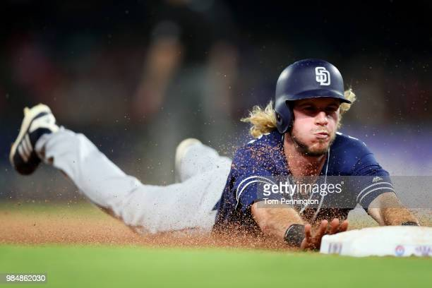 Travis Jankowski of the San Diego Padres slides safe into third base against the Texas Rangers in the top of the eighth inning at Globe Life Park in...