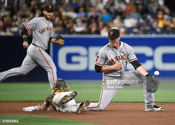 Travis Jankowski of the San Diego Padres steals second base as Grant Green of the San Francisco Giants loses the ball during the seventh inning of a...