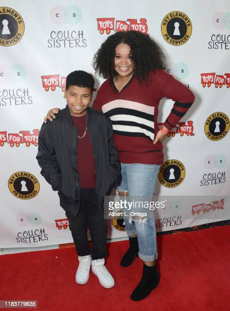 Travis Johnson and Mya Angelise attend The Couch Sisters 1st Annual Toys For Tots Toy Drive held onNovember 20 2019 in Glendale California