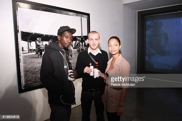 Travis Joseph Brett Moen and Heather Gil attend A Milk Gallery Project Presents Hunter Barnes The People at Milk Gallery on October 2 2008 in New...