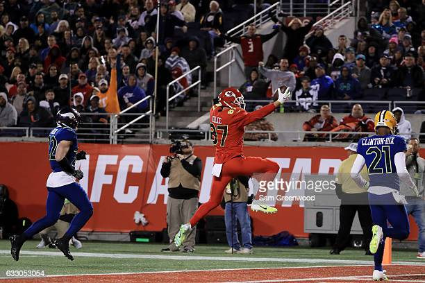 Travis Kelce of the AFC completes a pass for a touchdown in the second quarter against the NFC during the NFL Pro Bowl at the Orlando Citrus Bowl on...