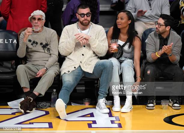 Travis Kelce of the Kansas City Chiefs and Kayla Nicole attend the Los Angeles Lakers and Memphis Grizzlies basketball game at Staples Center on...