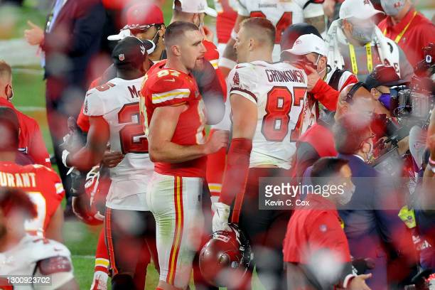 Travis Kelce of the Kansas City Chiefs and Rob Gronkowski of the Tampa Bay Buccaneers speak after Super Bowl LV at Raymond James Stadium on February...