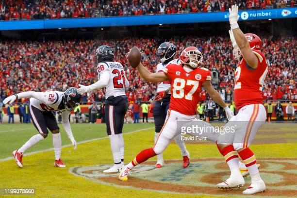 Travis Kelce of the Kansas City Chiefs and teammates celebrate his touchdown in the second quarter of the AFC Divisional playoff game against the...