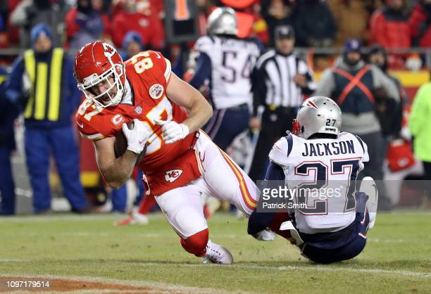 Travis Kelce of the Kansas City Chiefs catches a 12 yard touchdown pass in the third quarter against JC Jackson of the New England Patriots during...