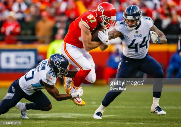 Travis Kelce of the Kansas City Chiefs catches a second quarter pass over Adoree' Jackson of the Tennessee Titans and Kamalei Correa of the Tennessee...