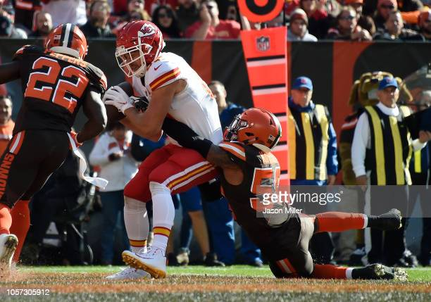Travis Kelce of the Kansas City Chiefs catches a touchdown in front of Christian Kirksey of the Cleveland Browns during the second quarter at...