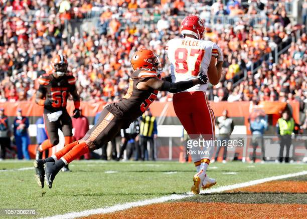 Travis Kelce of the Kansas City Chiefs catches a touchdown pass in front of Christian Kirksey of the Cleveland Browns during the second quarter at...