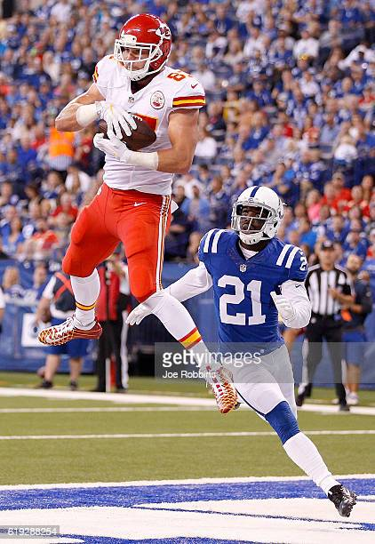 Travis Kelce of the Kansas City Chiefs catches a touchdown pass while being guarded by Vontae Davis of the Indianapolis Colts during the second...