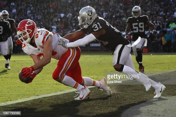 Travis Kelce of the Kansas City Chiefs catches his second touchdown pass of the game against the Oakland Raiders during their NFL game at...