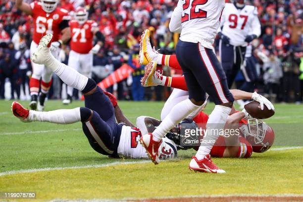 Travis Kelce of the Kansas City Chiefs catches touchdown reception against Lonnie Johnson Jr. #32 the Houston Texans during the second quarter of the...