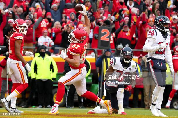 Travis Kelce of the Kansas City Chiefs celebrates a five yard touchdown reception against the Houston Texans during the second quarter in the AFC...