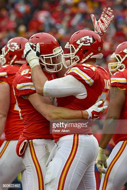 Travis Kelce of the Kansas City Chiefs celebrates a touchdown with teammate Brian Parker at Arrowhead Stadium during the first quarter of the game...