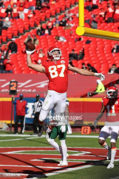 Travis Kelce of the Kansas City Chiefs celebrates after a three-yard touchdown against the New York Jets during their NFL game at Arrowhead Stadium...