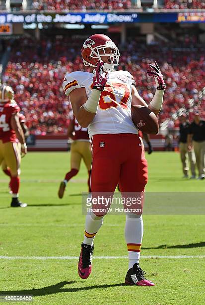 Travis Kelce of the Kansas City Chiefs celebrates after he scored a touchdown against the San Francisco 49ers during the first quarter at Levi's...