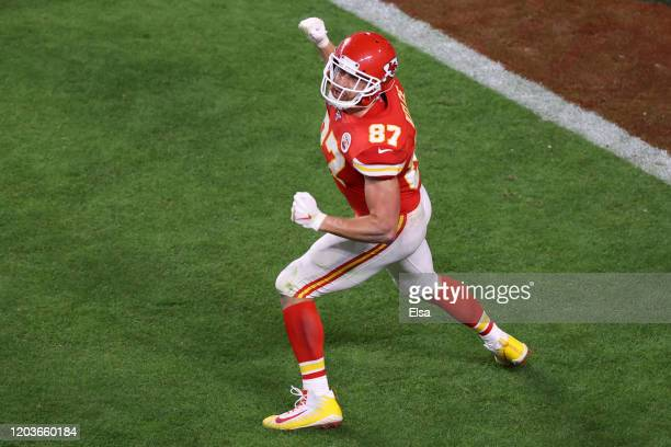 Travis Kelce of the Kansas City Chiefs celebrates after scoring a touchdown against the San Francisco 49ers during the fourth quarter in Super Bowl...