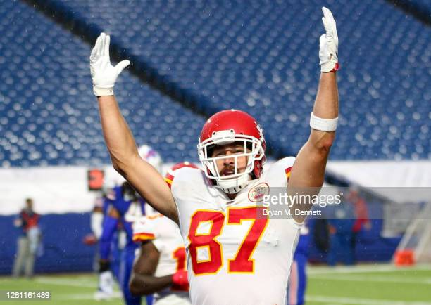 Travis Kelce of the Kansas City Chiefs celebrates after scoring a twelve-yard touchdown reception against the Buffalo Bills during the first half at...