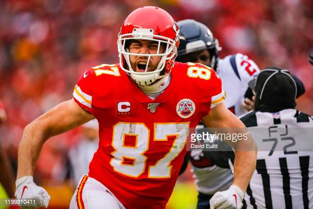 Travis Kelce of the Kansas City Chiefs celebrates his pass catch and run during the second quarter of the AFC Divisional playoff game against the...