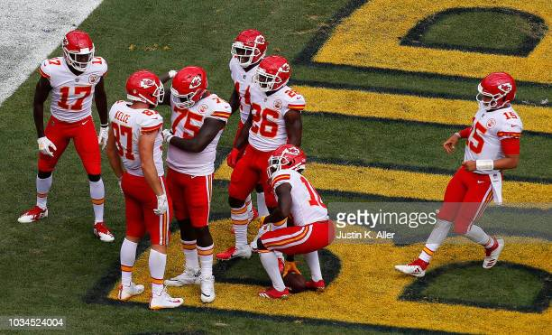 Travis Kelce of the Kansas City Chiefs celebrates with Cameron Erving after a 25 yard touchdown reception in the second half during the game against...